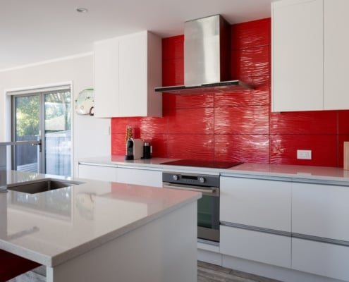 Kitchen Renovation Auckland with Red Tiled Splashback